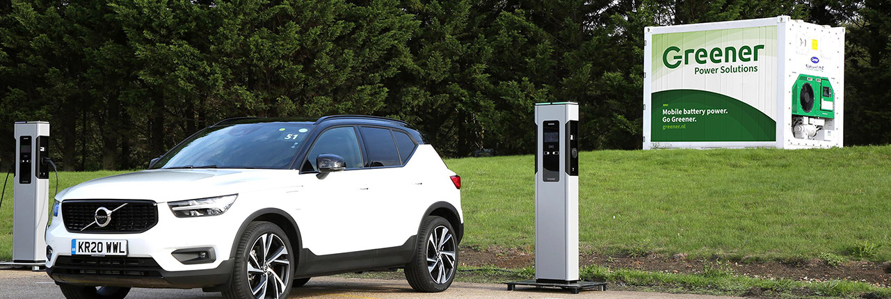 Electric vehicle charging at a mobile charging station