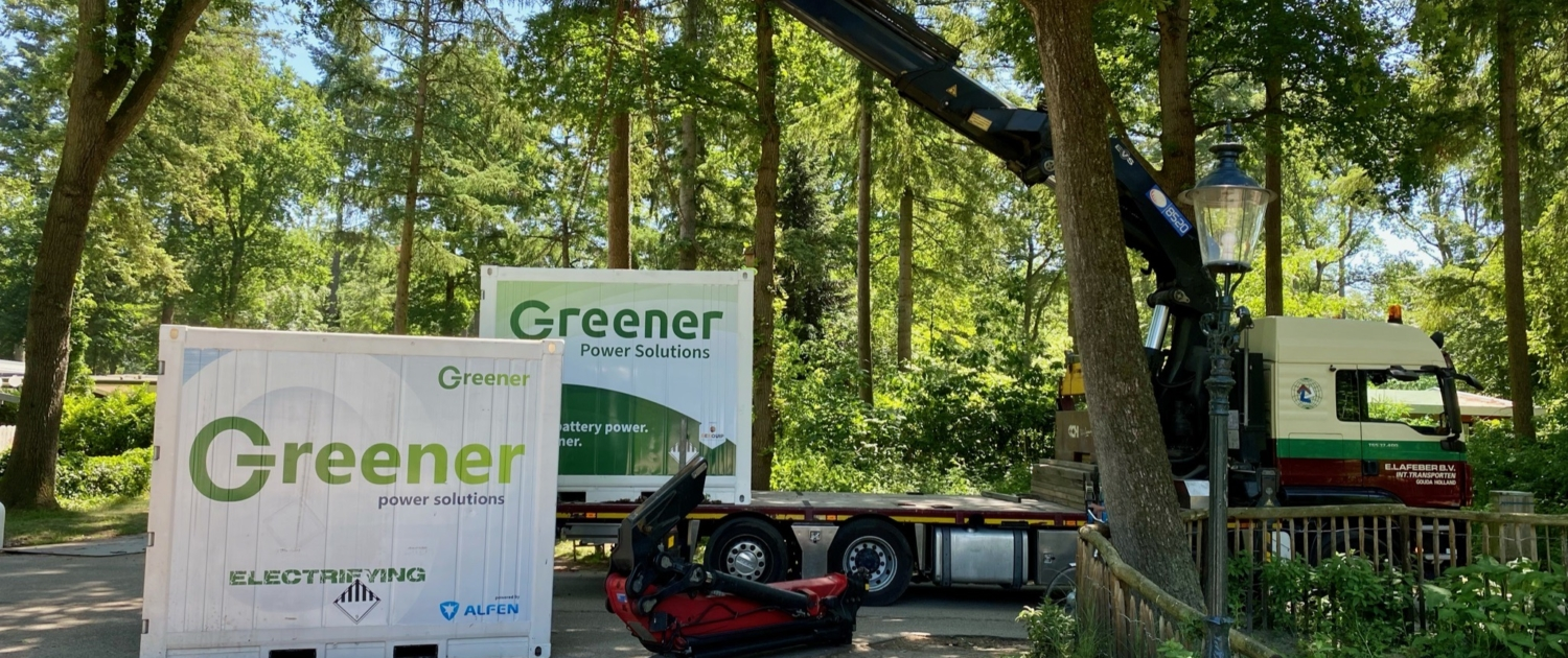 Two of our Greener batteries with the old and new branding in the forest